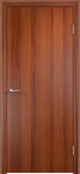 Глухая гладкая ламинированная дверь эконом класса в цвете итальянский орех производства фабрики Верда